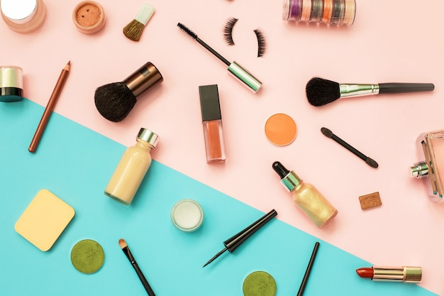 Set of decorative cosmetics on color background. makeup cosmetics tools background
