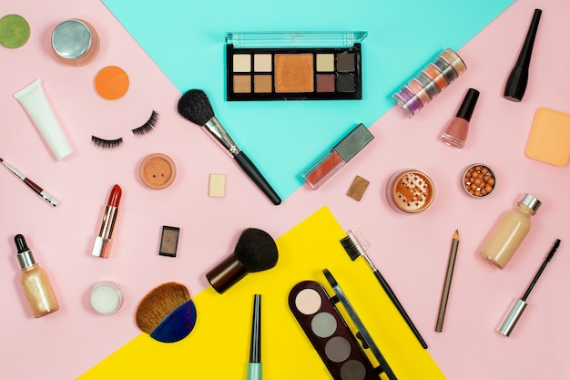 Set of decorative cosmetics on color background.