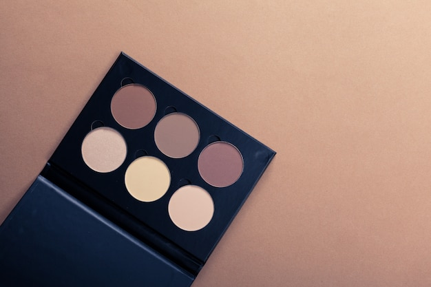 Set of decorative cosmetics on light color