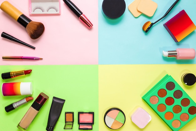 Set of decorative cosmetics, professional makeup tools brushes on color background.
