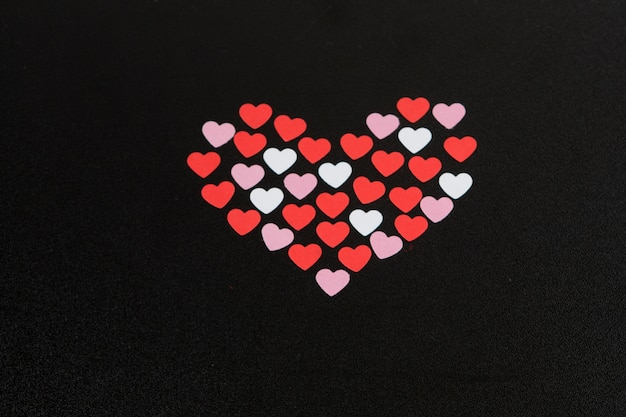 Set of decorative hearts on dark board