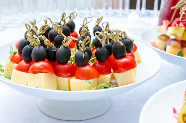 Set of delicious canapes with cheese, cherry tomatos and olive