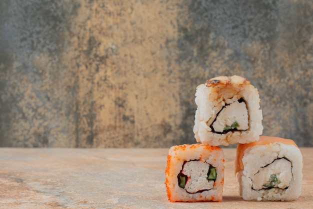 Set of delicious sushi roll on marble surface