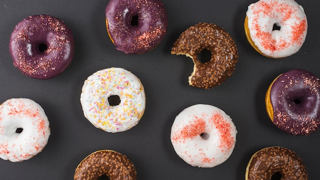 Set of delicious sweet bitten donuts with colorful coating