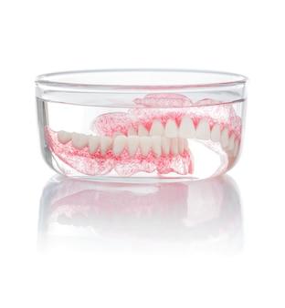 Set of dentures in water