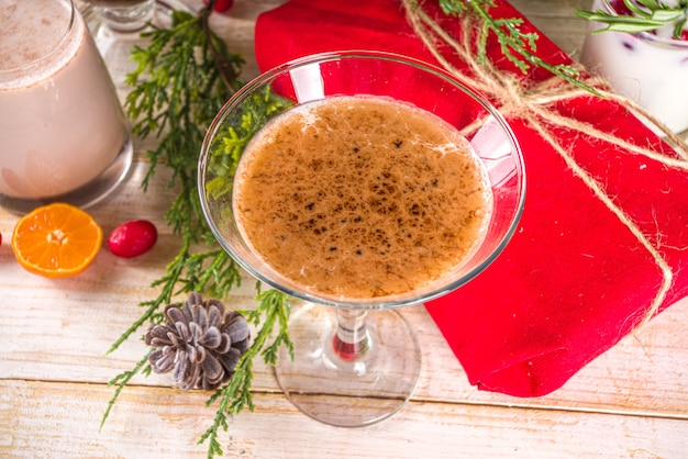 Set of different christmas drinks in cozy wooden home with xmas decor