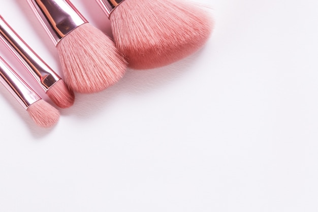 Set of different cosmetic brushed on white background, copy space