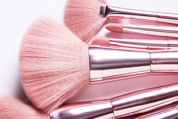 Set of different cosmetic brushed on white background