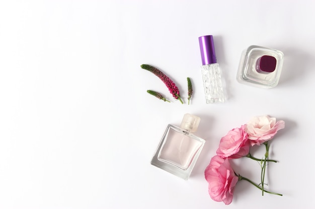 Set of different perfumes on a light background
