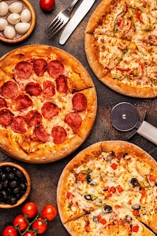 Set of different pizzas pepperoni, vegetarian, chicken with vegetables