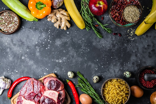 Set of different products for a healthy diet - meat, cereals, vegetables and fruits top view, choice between vegetarian and meat food, free space for text. high quality photo