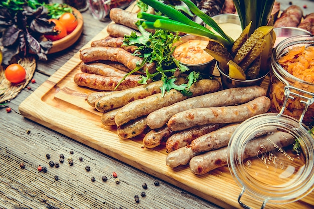 A set of different sausages, grilled on plate