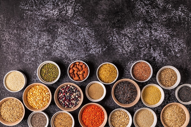 Set of different superfoods- whole grains, beans and legumes, seeds and nuts, top view.