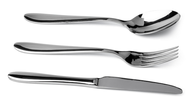 Set of dining cutlery isolated on white close up