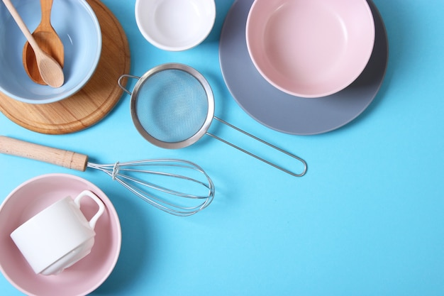 Set of dishes and kitchen utensils top view