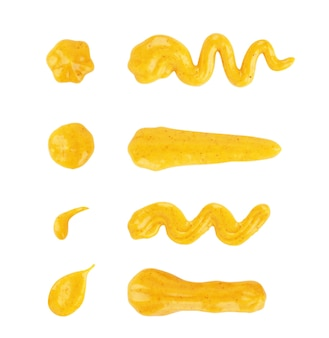 Set of drips of mustard sauces of different shapes on a white background