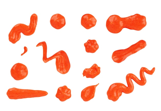 Set of drips of sauces of different shapes on a white background