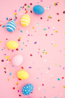 Set of easter eggs between colourful confetti
