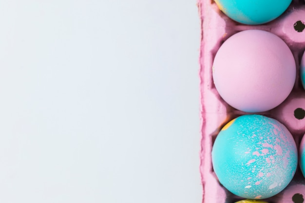 Set of easter eggs in pink container