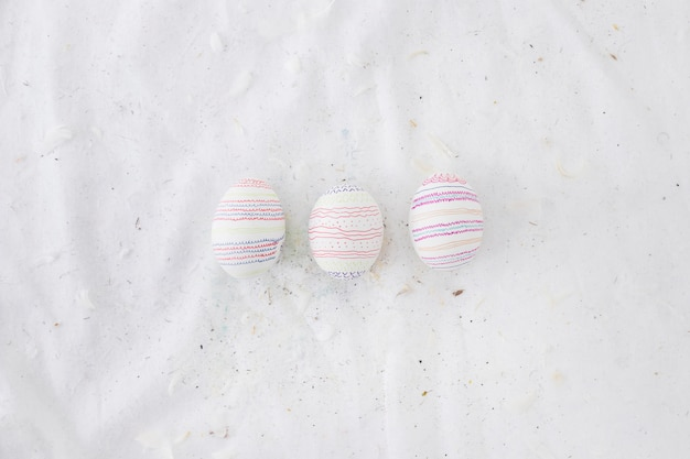 Set of easter eggs with patterns and feathers on textile