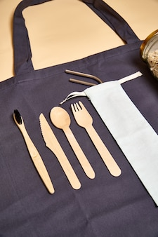 Set of eco friendly bamboo cutlery, eco bag, metal straw