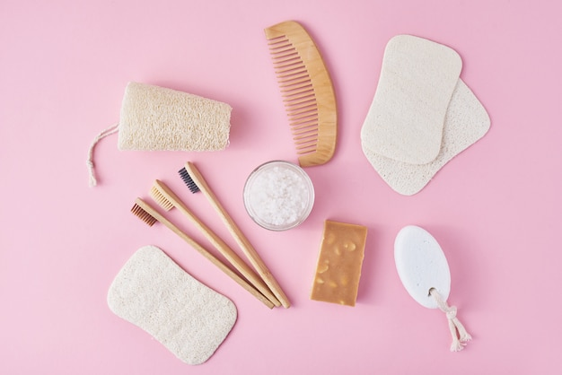 Set of eco friendly personal hygiene objects on pink, zero waste beauty concept