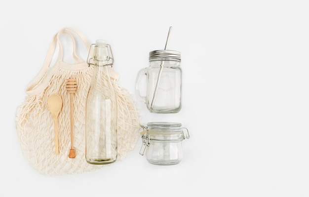 Set of eco friendly shopping bag, water bottle, honey dippe, wooden spoon. plastic free concept.