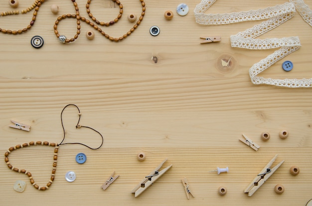 Set of elements for handicraft and decorative items for handmade on wooden background.