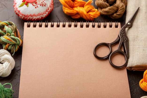 Set for embroidery, embroidery hoop, linen fabric, thread, scissors, embroidered needle bed and notepad
