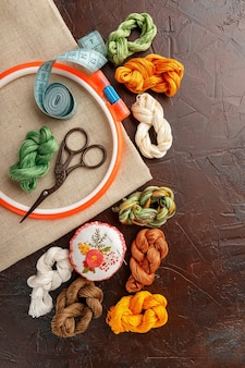 Set for embroidery, embroidery hoop, linen fabric, thread, scissors, embroidered needle bed.