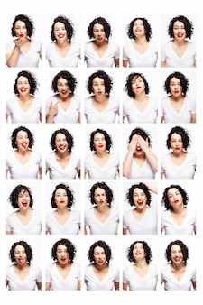 Set of emotions of a young beautiful woman. bright brunette with curly hair and red lipstick. white background. vertical.