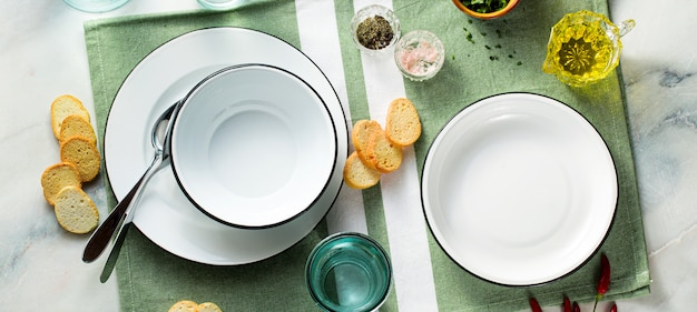 Set of empty plates on a table.