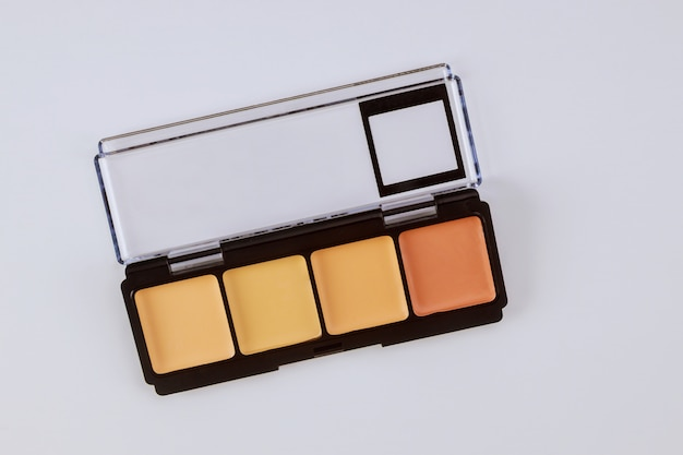Set of eyeshadows in pastel beige colors pallet brown matte shadows, closeup of makeup product on an isolated white table