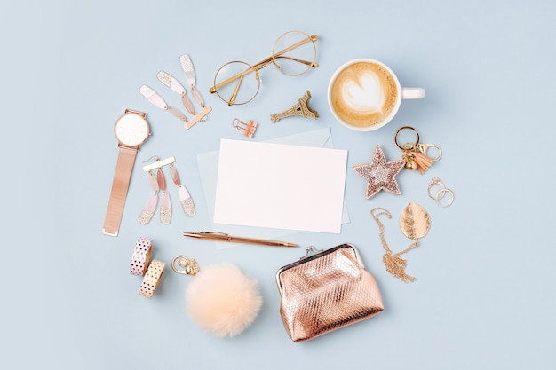 Set of female accessory and  mockup card on blue background. flat lay