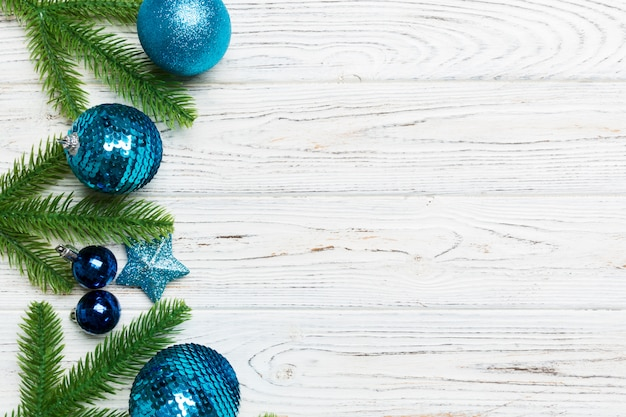 Set of festive balls, fir tree and christmas decorations on wooden background.