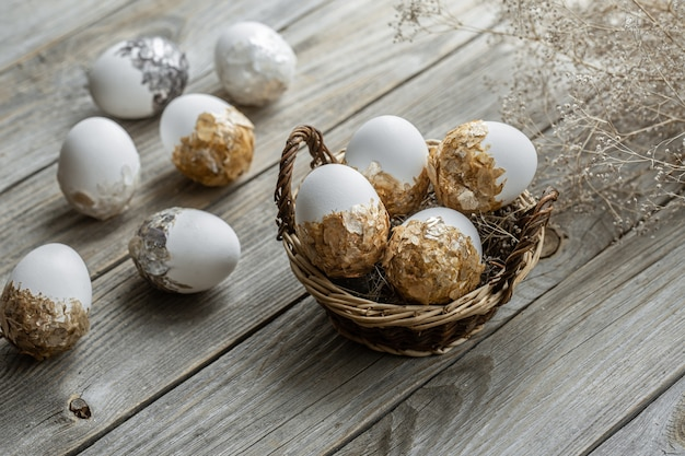 Set of festive easter eggs in a wicker basket on a blurred table. easter holiday concept.