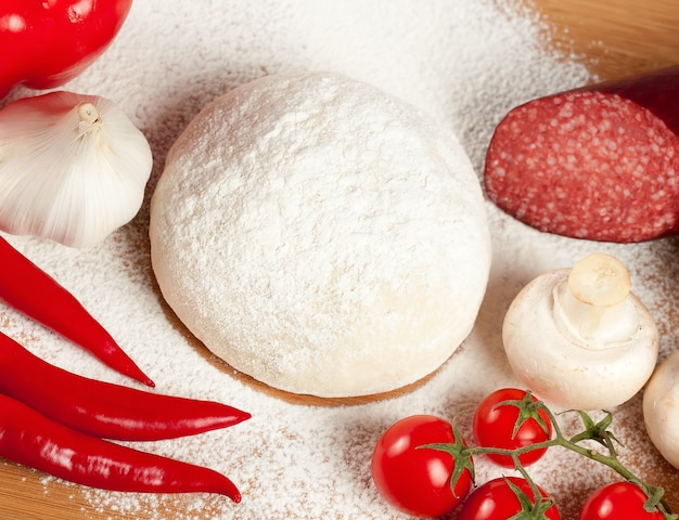 A set of food products for cooking pizza.