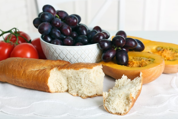 Set of food products on table, fruits and bread