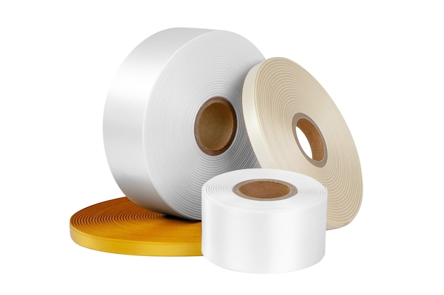 Set of four coils of silk ribbons in white beige orange different sizes for labels or branding isolated without shadows
