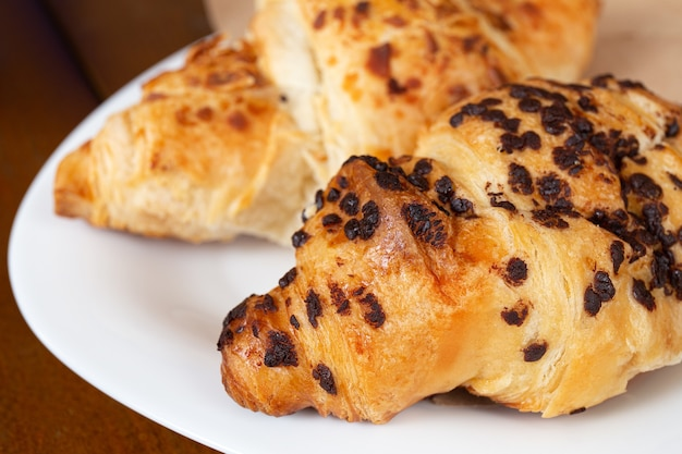 Set of fresh baked croissants on wooden table. french croissant.