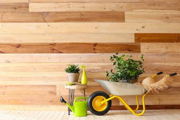 Set of gardening supplies near wooden wall