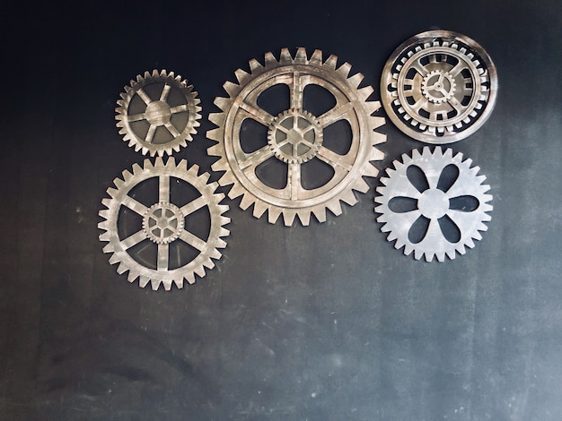 Set of gears decorated on black wall background and texture