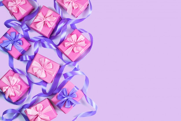 A set of gifts for a newborn pink color on a violet background