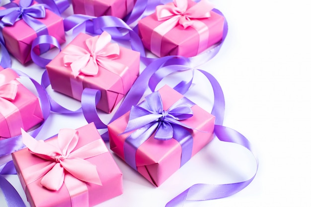 A set of gifts for a newborn pink color on a white background a top view of flat lay copy space