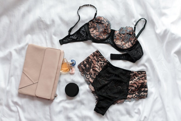 Set of glamorous stylish sexy lace lingerie with woman accessories, beauty products