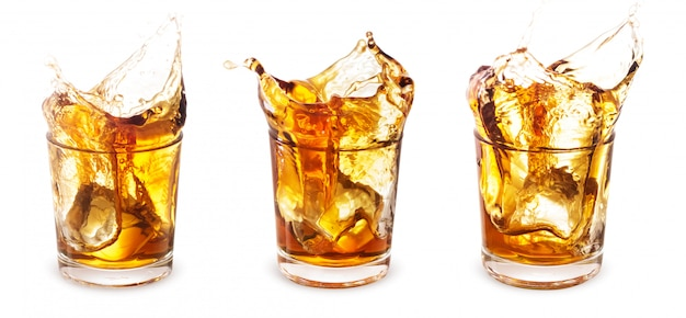 Set of glasses of whiskey with a splash