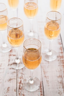 Set of glasses with champagne on the table