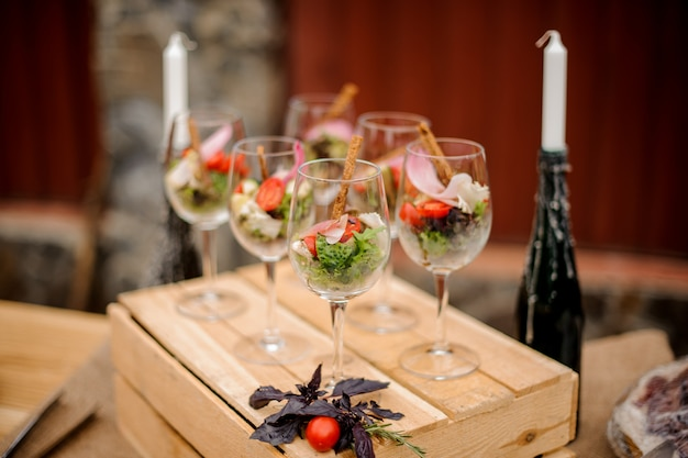 Set of glasses with fresh vegetable salad