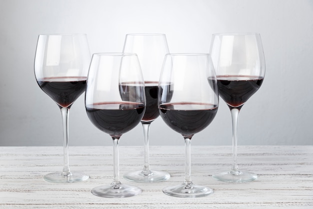 Set of glasses with red wine on table