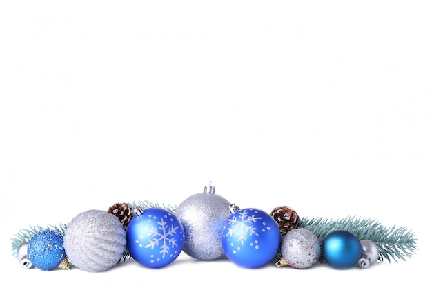 Set of gold christmas balls with decor isolated on white